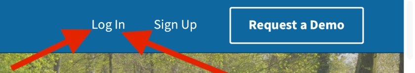 arrows pointing to the log in link, third link from the right at the top of Schoology's home page.